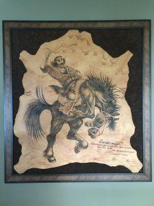 Cowhide artwork with Argentine gaucho on horseback.